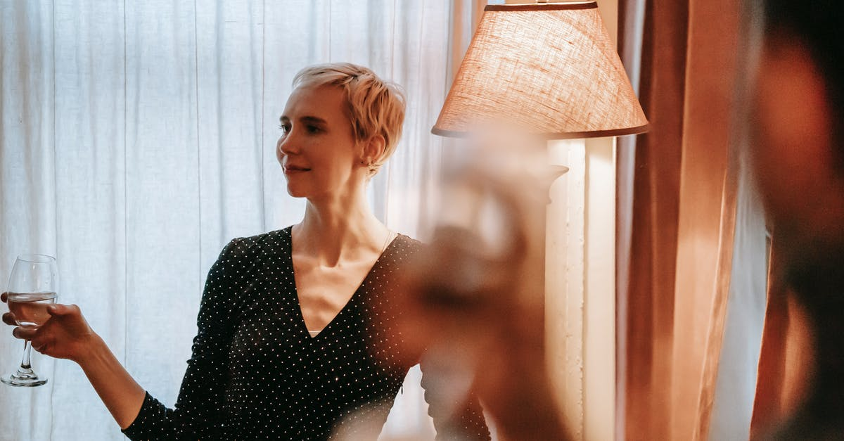 A woman standing in front of a curtain