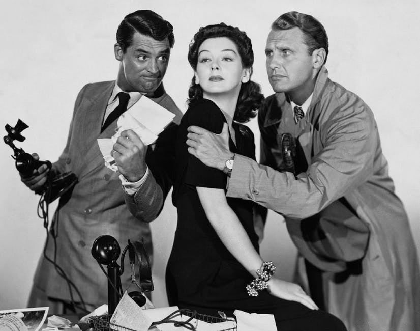 Rosalind Russell, Ralph Bellamy posing for the camera